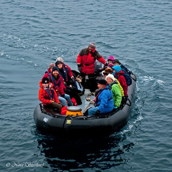 Passengers arriving in Zodiac