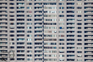Nikon D850 with AF-S Nikkor 500mm PF ED VR f5.6  ISO 200 - Shutter 1/1000 - Aperture f7.1 With a telephoto lens, look for lines and patterns in the environment outside your window. There's interesting repetition in many of the high-rises around our neighbourhood. Take your creativity further during the editing process. Colours can be altered to enhance the abstract quality of the pattern.