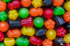 Nikon D5 with AF-S Micro Nikkor 105mm f2.8  ISO 640 - Shutter 1/4 - Aperture f18 Everyone loves Candy. Not only sweet and tasty, but they often have an appealing or appetizing appearance. They make wonderful photographic subjects, especially when arranged in colourful and symmetrical patterns like these JuJubes.