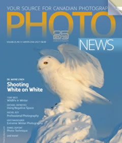 cover page of Phots news with a Snowy Owl